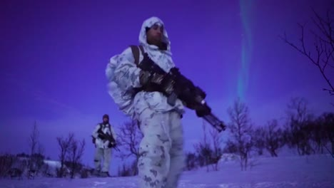 Norwegian-Army-Soldiers-Exercise-Ground-Tactics-At-Night-With-The-Northern-Lights-In-Background