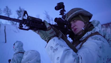 Norwegian-Army-Soldiers-Exercise-Ground-Tactics-In-The-Winter-In-Snow-Using-Skis-And-Snowmobiles