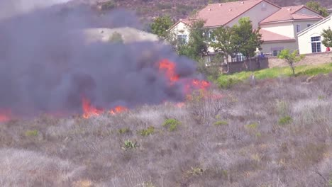 Fire-Crews-Battle-To-Gain-Control-Of-A-Brush-Fire-Burning-Near-A-Southern-California-Neighborhood