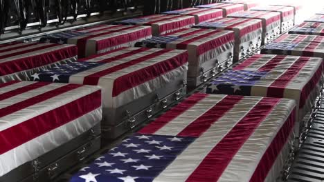 Pan-Across-Flag-Draped-Coffins-Of-Dead-Us-Soldiers-Being-Returned-Home-In-A-C130-Cargo-Plane