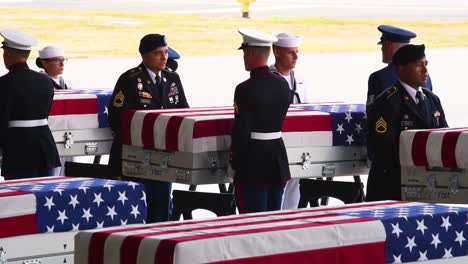 Flag-Draped-Coffins-Of-Dead-Us-Soldiers-Being-Returned-Home-Are-Displayed-In-A-Military-Hangar-2
