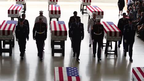 Flag-Draped-Coffins-Of-Dead-Us-Soldiers-Being-Returned-Home-Are-Displayed-In-A-Military-Hangar-3