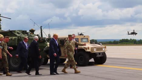 Us-President-Donald-J-Trump-Greets-Commanders-And-Watches-An-Aerial-Display-During-His-Visit-To-Fort-Drum-Ny-To-Sign-The-2019-National-Defense-Authorization-Act