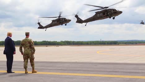 Us-President-Donald-J-Trump-Greets-Commanders-And-Watches-An-Aerial-Display-During-His-Visit-To-Fort-Drum-Ny-To-Sign-The-2019-National-Defense-Authorization-Act-1