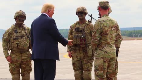 Us-President-Donald-J-Trump-Greets-Commanders-And-Watches-An-Aerial-Display-During-His-Visit-To-Fort-Drum-Ny-To-Sign-The-2019-National-Defense-Authorization-Act-6