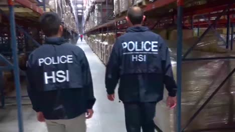 Us-Ice-Immigration-And-Customs-Enforcement-Agents-Comb-A-Warehouse-Where-Smugglers-Were-Caught-Smuggling-Millions-Of-Dollars-Of-Counterfeit-Luxury-Goods-From-China-Into-The-United-States