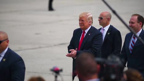 The-President-Of-The-United-States-Donald-J-Trump-Walks-On-A-Tarmac-And-Greets-Admiring-Army-Military-Personnel-At-A-Rally-Gets-Into-Limousine