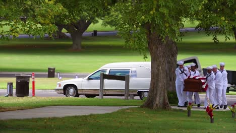 Flag-Draped-Coffins-Of-A-War-Dead-Us-Soldier-Is-Transported-Through-A-Cemetery-For-Burial