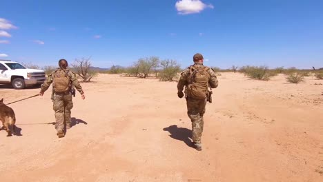 Members-Of-The-Us-Border-Patrol-Walk-With-A-K9-Canine-Dog-To-A-Waiting-Border-Patrol-Vehicle