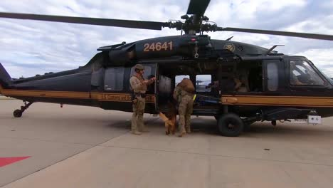 Members-Of-The-Us-Border-Patrol-Walk-With-A-K9-Canine-Dog-To-A-Waiting-Helicopter
