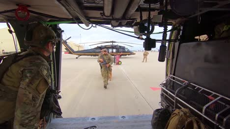 Members-Of-The-Us-Border-Patrol-Walk-With-A-K9-Canine-Dog-To-A-Waiting-Helicopter-1