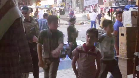 Scenes-On-The-Busy-Street-In-Mosul-Iraq-With-Market-Stalls-And-Pedestrians