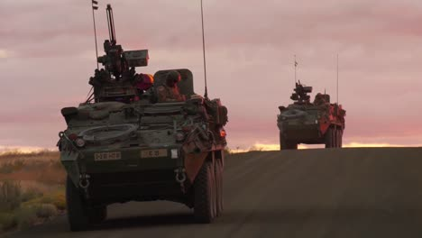 A-Convoy-Of-Us-Military-Vehicles-Travels-At-Sunset-Or-Sunrise-In-A-Foreign-Country