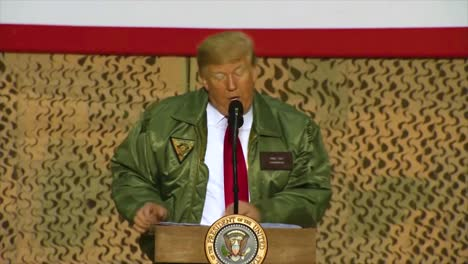 Us-President-Donald-Trump-Makes-A-Surprise-Christmas-Visit-To-Us-Troops-In-Iraq-And-Claims-Falsely-That-He-Has-Just-Given-Soldiers-The-Biggest-Pay-Raise-In-Ten-Years-And-One-Of-The-Biggest-In-History