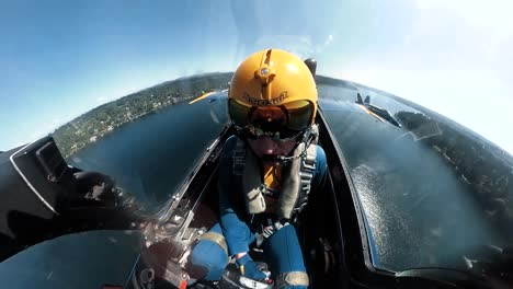 A-Us-Navy-Blue-Angel-Pilot-Is-Seen-In-His-Aircraft-Flying-Over-Seattle-As-He-Rolls-Upsidedown-In-An-Air-Show