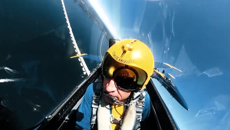 A-Us-Navy-Blue-Angel-Pilot-Is-Seen-In-His-Aircraft-Flying-Over-Seattle-As-He-Rolls-Upsidedown-In-An-Air-Show-1