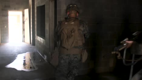Us-Marines-Prepare-To-Fire-From-Windows-During-Military-Operations-On-Urban-Terrain-Training-At-Camp-Lejeune