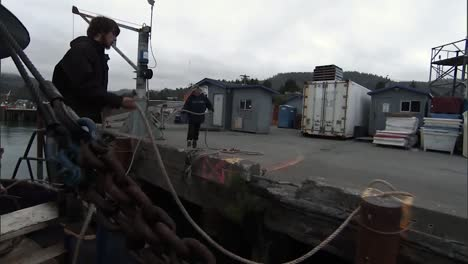 Trawlers-Dock-Their-Vessel-And-Begin-Unloading-Their-Catch