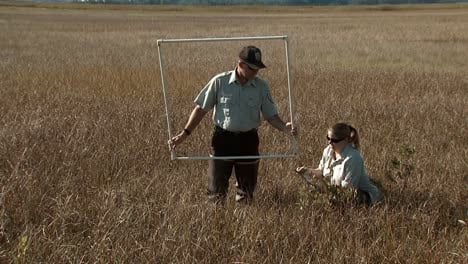 A-Man-And-Woman-Of-The-Usfws-Manage-Water-Levels-In-Delaware-S-Bombay-Hook-National-Wildlife-Refuge
