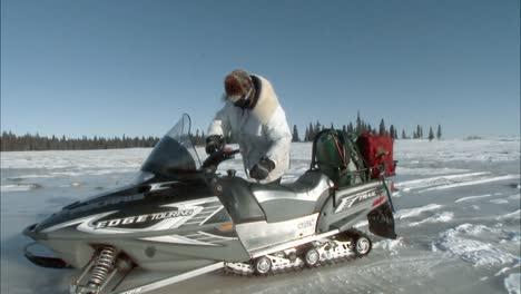 A-Man-Rides-A-Snowmobile-Through-Alaska-S-Togiak-National-Wildlife-Refuge