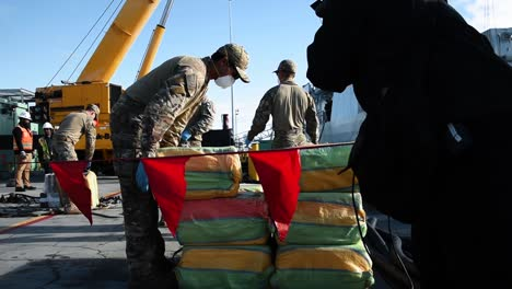 Us-Coast-Guardsmen-And-Canadian-Navy-Sailors-Begin-To-Unload-Seized-Cocaine-From-A-Canadian-Ship