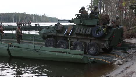 Us-Marines-Drive-Amphibious-Vehicles-Onto-Barges-During-A-Training-Exercise
