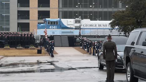 Servicemen-Of-The-Different-Branches-Of-The-Us-Armed-Forces-Stand-At-Attention-At-Texas-College-Station-As-The-Train-Carrying-President-Bush-S-Casket-Pulls-In