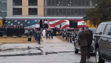 Hail-To-The-Chief-Is-Played-As-Clergymen-And-Servicemen-And-Servicewomen-March-With-President-Bush-S-Casket-At-Texas-College-Station