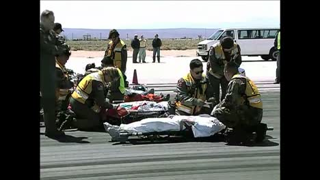 Space-Shuttle-Crewmen-Are-Carried-On-Stretchers-And-Then-Airlifted-In-A-Helicopter-During-An-Evacuation-Exercise-At-Dryden-Flight-Research-Center-In-California