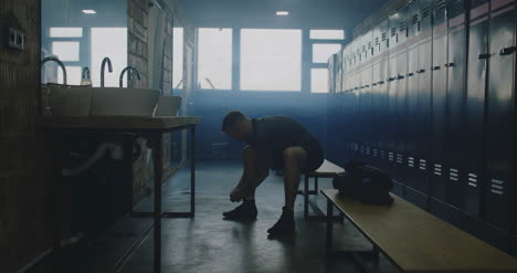 Man-Tying-Shoes-in-Locker-Room