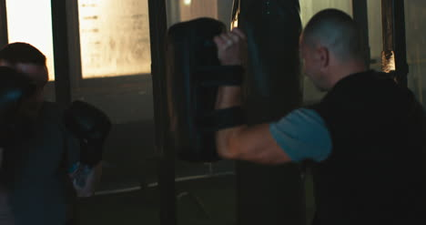 Men-Practicing-Hits-in-Boxing-Gym