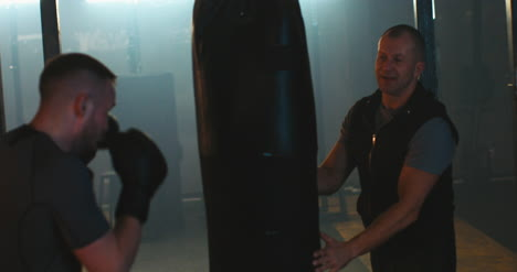 Man-Boxing-Punching-Bag-in-Gym-02