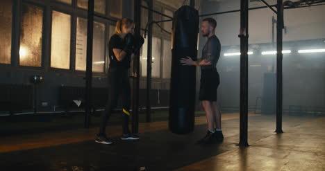 Woman-Hitting-Punching-Bag-in-Gym