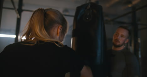 Woman-Boxing-Punching-Bag-in-Gym