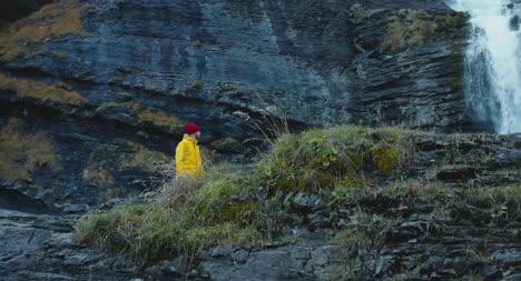 Man-Hiking-Up-Rocky-Terrain-01