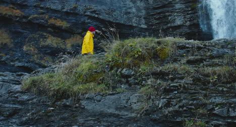 Man-Hiking-Up-Rocky-Terrain-02