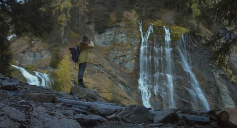 Woman-Photographing-Waterfall