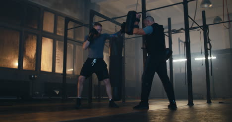 Man-Boxing-with-Trainer