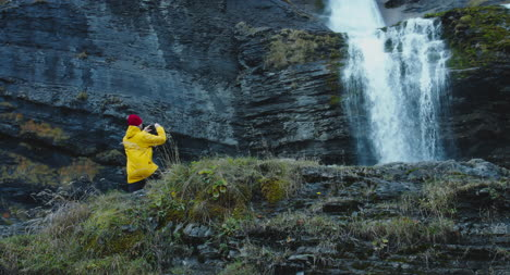 Man-Photographing-Waterfall