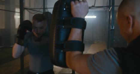 Man-Hitting-Boxing-Pads