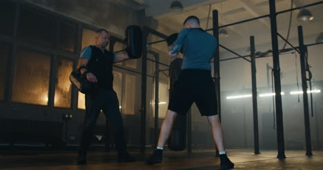 Man-and-Boxing-Coach-in-Gym