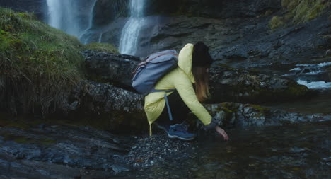 Young-Female-Hiker-Next-to-Waterfall-02