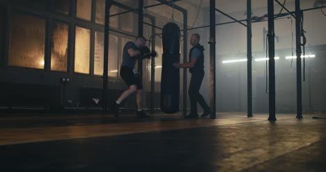 Coach-Training-Male-Boxer