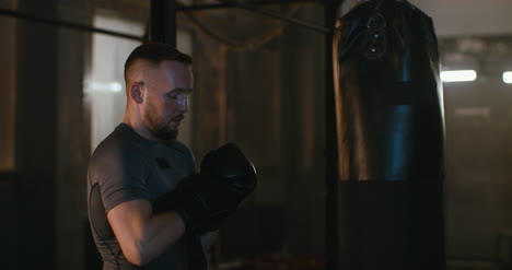 MMA-Fighter-Putting-on-Gloves