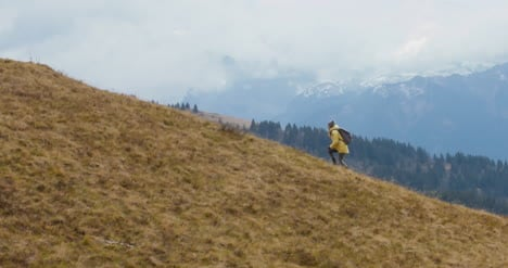 Hiker-Running-up-Hillside