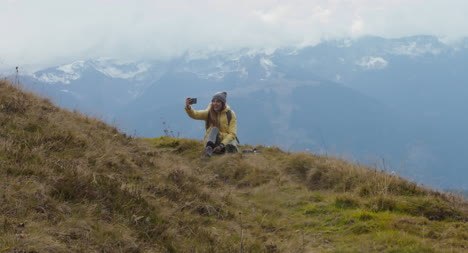 Woman-Taking-Selfie-on-a-Hill