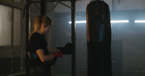 Woman-Putting-on-Boxing-Gloves
