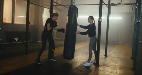 Boxer-and-Trainer-with-Punching-Bag