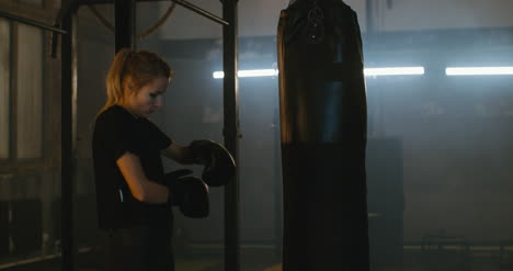 Woman-Donning-Boxing-Gloves
