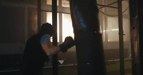 Boxer-Hitting-Punching-Bag-Hard